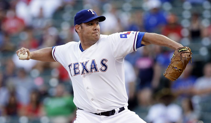 Texas Rangers starting pitcher Colby Lewis works against the Tampa Bay Rays in the first inning of a baseball game, Monday, Aug. 11, 2014, in Arlington, Texas. (AP Photo/Tony Gutierrez)