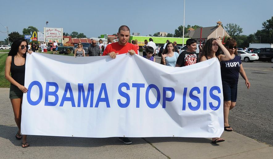 Protestors call on President Obama to help end the bloodshed of the Islamic State. (Associated Press/File)