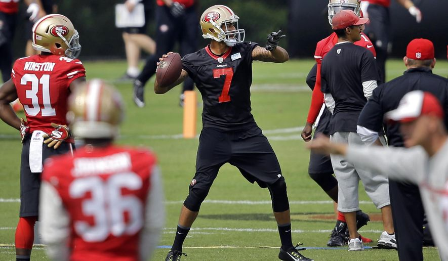 San Francisco 49ers quarterback Colin Kaepernick (7) throws a pass to a receiver during an NFL football training camp practice, Monday, Aug. 11, 2014, in Owings Mills, Md. (AP Photo/Patrick Semansky)