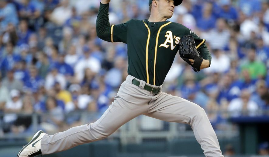 Oakland Athletics starting pitcher Sonny Gray throws during the first inning of a baseball game against the Kansas City Royals, Monday, Aug. 11, 2014, in Kansas City, Mo. (AP Photo/Charlie Riedel)