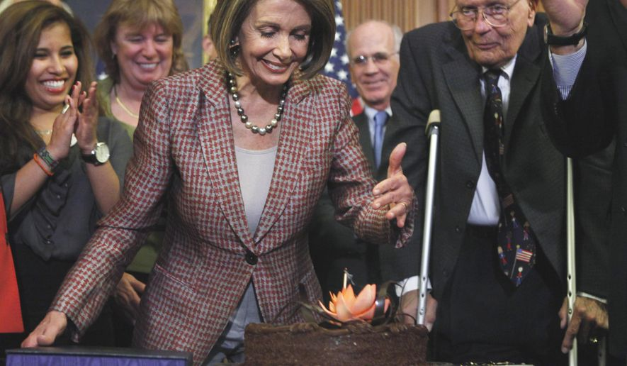 **FILE** House Speaker Nancy Pelosi, California Democrat, blows her birthday cake during a bill enrollment ceremony on Capitol in Washington on March 26, 2010. (Associated Press)
