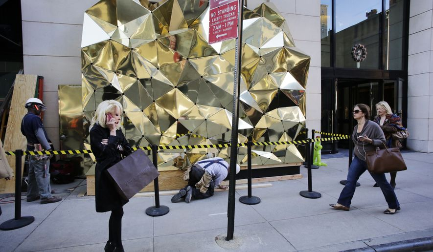 **FILE** A shopper stands in front of Barneys New York on Nov. 18, 2013. (Associated Press)