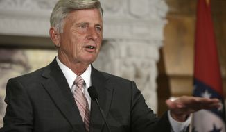 Arkansas Gov. Mike Beebe announces that the state Department of Education has partnered with EducationSuperHighway at the Arkansas state Capitol in Little Rock, Ark., Monday, Aug. 11, 2014. EducationSuperHighway is a nonprofit dedicated to improving Internet access in schools. (AP Photo/Danny Johnston)