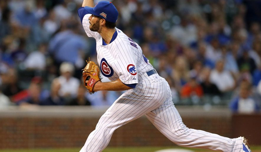 Chicago Cubs starting pitcher Jake Arrieta delivers during the first inning of a baseball game against the Milwaukee Brewers Monday, Aug. 11, 2014, in Chicago. (AP Photo/Charles Rex Arbogast)