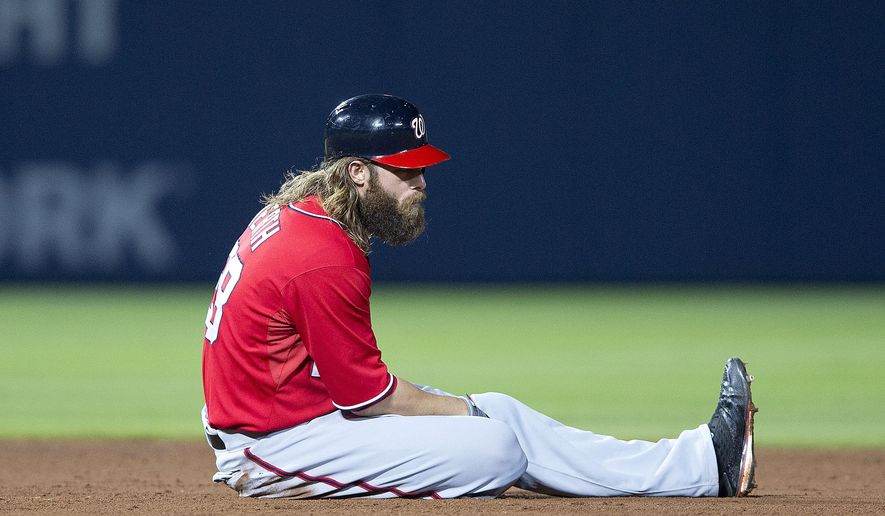 Washington Nationals right fielder Jayson Werth (28) sits on the field after being forced out at second base on a double play in the eighth of a baseball game  Sunday, Aug. 10, 2014 in Atlanta. Atlanta won 3-1.  (AP Photo/John Bazemore)