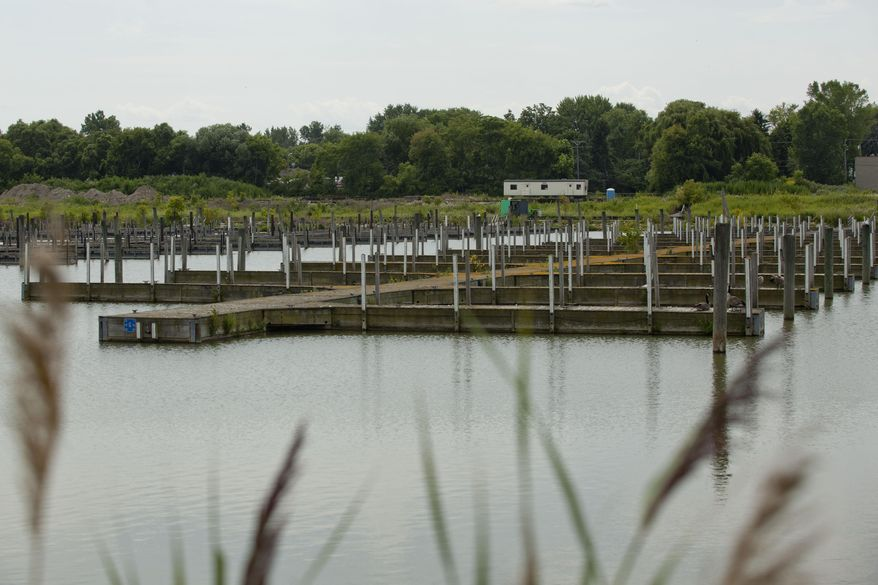 This Aug. 6, 2014 photo shows the site at the former Water Street Marina, in Port Huron, Mich. Plans for a Holiday Inn Express are still underway for the site. (AP Photo/Times Herald, Jeffrey Smith)