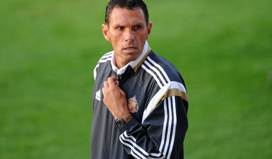 Sunderland Premier soccer team manager Gus Poyet, of Uruguay, looks out during the pre-season friendly against Spanish team Real Betis at Heritage Park, Sunderland, Thursday Aug. 7, 2014. (AP Photo / Owen Humphreys, PA) UNITED KINGDOM OUT - NO SALES - NO ARCHIVES