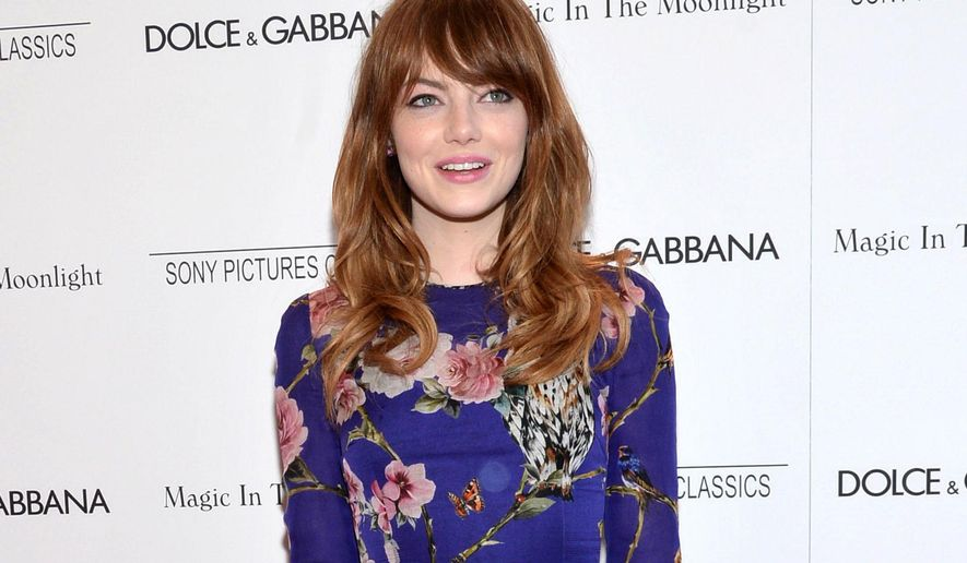 "FILE - This July 16, 2014 file photo shows actress Emma Stone arrives at the premiere of ""Magic In The Moonlight"" in New York. Roundabout Theatre Company said Monday, Aug. 11, that Stone is in negotiations to make her Broadway debut as Sally Bowles in ""Cabaret."" (Photo by Evan Agostini/Invision/AP, FIle)"