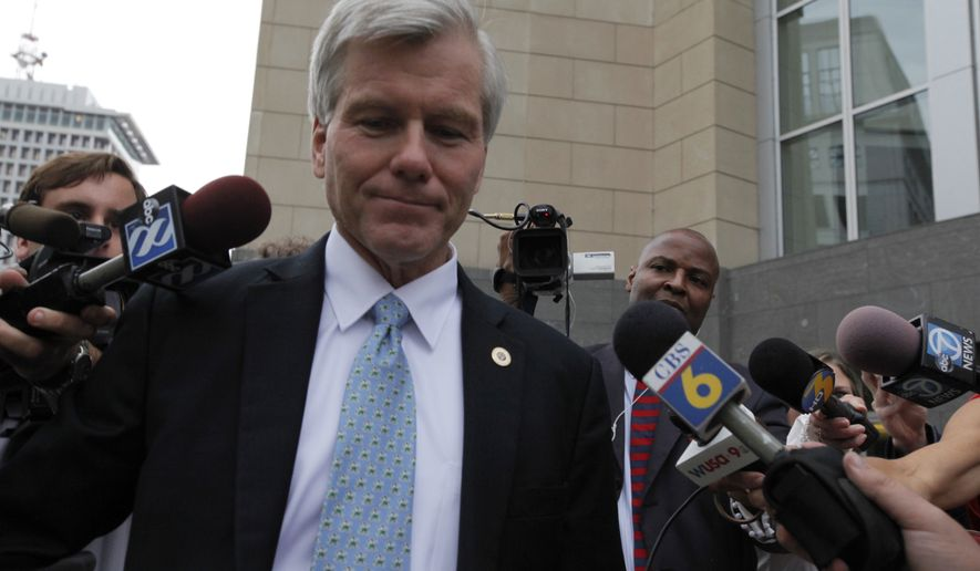 Former Virginia governor Bob McDonnell is surrounded by media after he left the federal courthouse in Richmond, Va., Monday, Aug. 11, 2014, as the federal corruption trial of McDonnell and former first lady Maureen McDonnell continues into its third week.  (AP Photo/Richmond Times-Dispatch, Bob Brown).