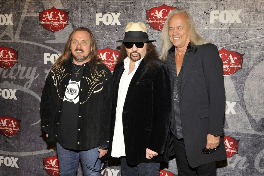 """FILE - This Dec. 10, 2012 file photo shows, from left, Johnny Van Zandt, Gary Rossington and Rickey Medlocke of Lynyrd Skynyrd at the American Country Awards in Las Vegas. An all-star cast of performers will salute the seminal Southern rock back during the taping of """"One More For The Fans! Celebrating the Songs & Music of Lynyrd Skynyrd. The Nov. 12 concert will feature performances from Gregg Allman, Alabama, Charlie Daniels, Peter Frampton, John Hiatt, Jamey Johnson, Cheap Trick, among others.(Photo by Jeff Bottari/Invision/AP, File)"""