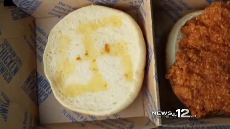 A McDonald's employee in Morehead City, North Carolina, has been fired after a woman found a swastika etched in butter on her chicken sandwich. (WCTI 12)