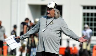 FILE - In this Aug. 5, 2014, file photo, New Orleans Saints defensive coordinator Rob Ryan gestures during the teams NFL football training camp in White Sulphur Springs, W.Va. One season after orchestrating a turnaround as the Saints' defensive coordinator, Ryan has an upgraded roster. (AP Photo/Chris Tilley) ** FILE **