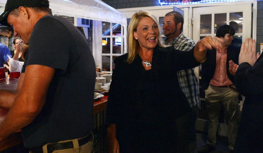 Heather Somers, a candidate for the Republican nomination for Connecticut lieutenant governor, arrives at a cafe in Groton, Conn., to wait with supporters for election returns Tuesday, Aug. 12, 2014. (AP Photo/The Day, Dana Jensen)