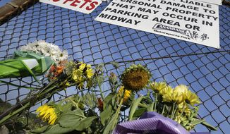 """A small memorial of flowers is seen at Canandaigua Motorsports Park Monday, Aug. 11, 2014, in Canandaigua, N.Y. On Saturday night, Tony Stewart struck and killed Kevin Ward Jr., 20, a sprint car driver who had climbed from his car and was on the track trying to confront Stewart during a race at the track in upstate New York. Ontario County Sheriff Philip Povero said his department's investigation is not criminal and that Stewart was """"fully cooperative"""" and appeared """"very upset"""" over what had happened. (AP Photo/Mel Evans)"""