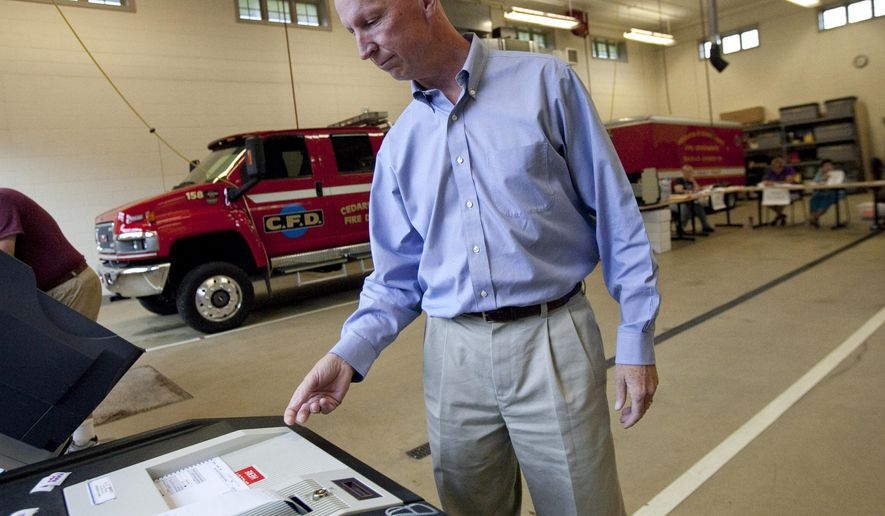 State Rep. Duey Stroebel casts his primary ballot Tuesday, Aug, 12, 2014, at the fire department in Cedarburg, Wis. Stroebel is running for the Republican nomination for the 6th Congressional District. (AP Photo/Milwaukee Journal Sentinel, Kristyna Wentz-Graff)