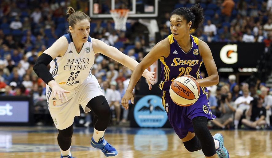 Los Angeles Sparks guard Kristi Toliver (20) pushes the ball down the court against Minnesota Lynx guard Lindsay Whalen (13) in the first half of a WNBA basketball game, Tuesday, Aug. 12, 2014, in Minneapolis. (AP Photo/Stacy Bengs) **FILE**