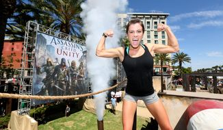 """Pioneers: The year's many female firsts include WNBA star Becky Hammon becoming assistant coach of the San Antonio Spurs, gymnast Kacy Catanzaro (shown here) completing the obstacle course on """"American Ninja Warrior,"""" Navy Adm. Michele Janine Howard's promotion to four-star admiral and Janet L. Yellen's serving as the first female chair of the Federal Reserve Board. (Associated Press)"""