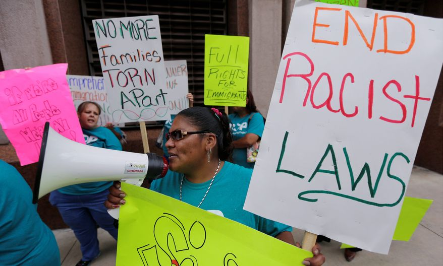 Supporters of immigration reform protest in San Antonio. Gay immigrants are now mounting a campaign to demand that they be included in any unilateral moves President Obama makes this year to halt deportations. (Associated Press)