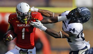 FILE - In this Sept. 7, 2013, file photo, Maryland wide receiver Stefon Diggs, left, pushes past Old Dominion safety Fellonte Misher while running for a touchdown in the first half of an NCAA college football game in College Park, Md. Coming off its best season under coach Randy Edsall, Maryland can't wait to mix it up on the football field with Big Ten powerhouses Ohio State, Michigan and Michigan State. (AP Photo/Patrick Semansky, File)