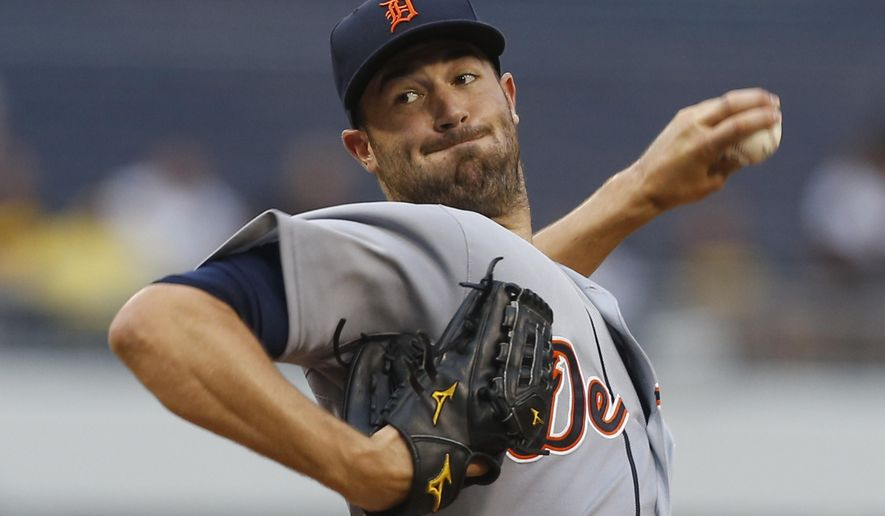 Detroit Tigers starting pitcher Robbie Ray throws against the Pittsburgh Pirates in the first inning of the baseball game on Tuesday, Aug. 12, 2014, in Pittsburgh. (AP Photo/Keith Srakocic)