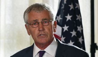 U.S. Secretary of Defense Chuck Hagel speaks to the media during a press conference at the conclusion of the AUSMIN talks at Admiralty House in Sydney, Tuesday, Aug. 12, 2014. Hagel and U.S. Secretary of State John Kerry are meeting with their Australian counterparts at the annual Australia-U.S. Ministerial Consultations (AUSMIN), which will focus on regional security and enhanced military co-operation. (AP Photo/Dan Himbrechts, Pool)