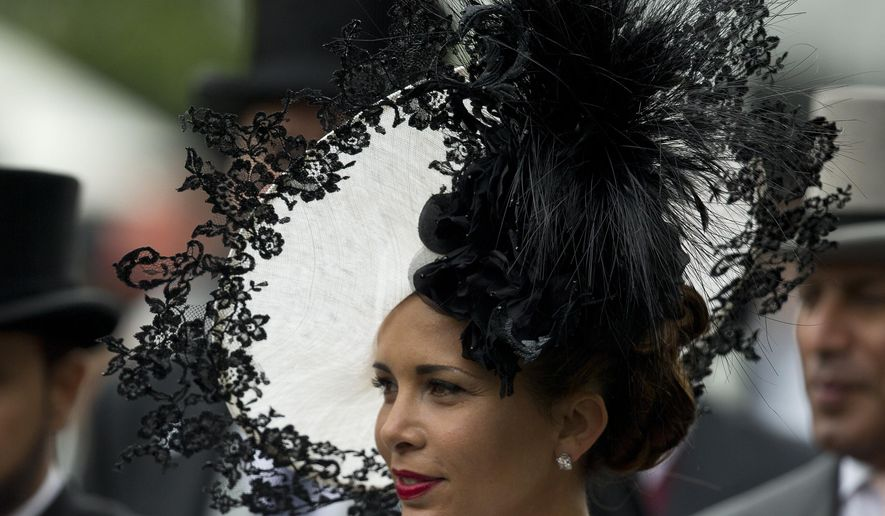 """FILE - This is a Thursday, June, 19, 2014 file photo of Princess Haya of Jordan as she wears an ornate hat in the parade ring on the third day of the Royal Ascot horse racing meeting, which is traditionally known as Ladies Day, at Ascot, England. International Olympic Committee  member Princess Haya of Jordan has cited her relief work for Gaza as a reason not to seek re-election as International Equestrian Federation president. Princess Haya was expected to win a third four-year term in December, when she will now also have to give up her Olympic position. """"In the last weeks, I have needed to put aside some of my work for the FEI to concentrate on humanitarian relief to Gaza,"""" the princess said in a statement released Tuesday Aug. 12, 2014 by the equestrian governing body.(AP Photo/Alastair Grant, File)"""