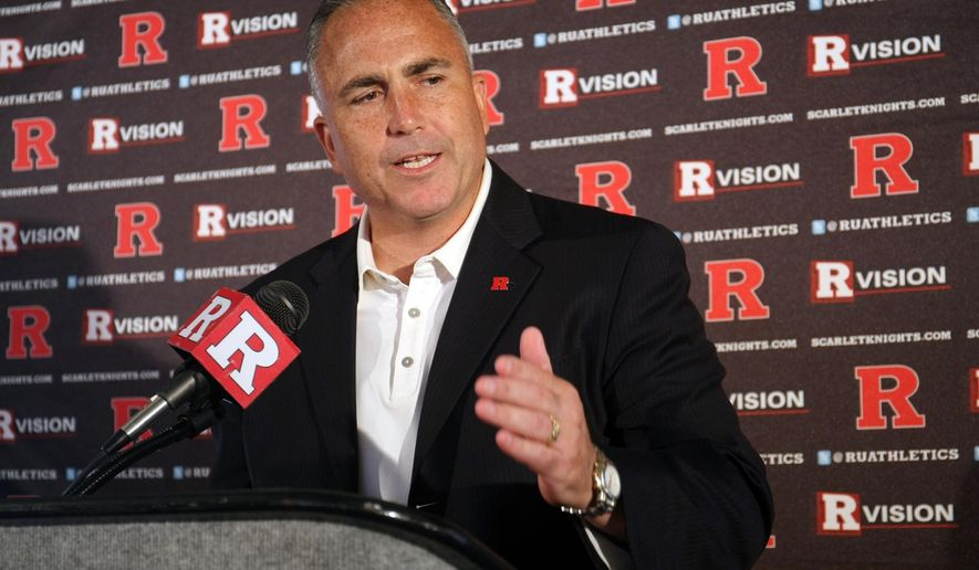 Rutgers football coach Kyle Flood speaks to reporters during the NCAA college football team's media day, Sunday, Aug. 10, 2014, in Piscataway, N.J. (AP Photo/Home News Tribune, Jason Towlen) NEWARK OUT;  NO SALES