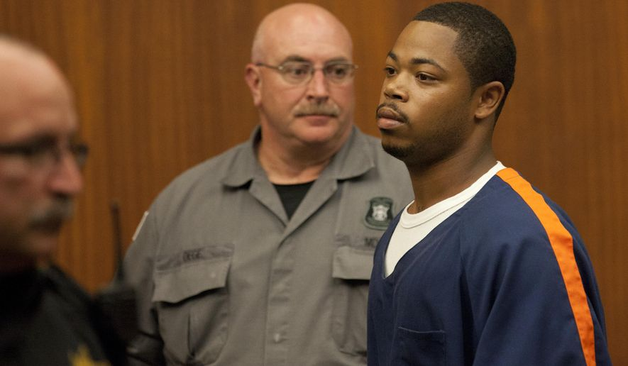 Kristopher Pratt exits court in Ann Arbor, Mich., after his sentencing Tuesday, Aug. 12, 2014, in the robbery-slaying of Eastern Michigan football player Demarius Reed. Pratt was sentenced to a minimum of 18 years, with a maximum of 30 years. (AP Photo/The Ann Arbor News, Patrick Record)