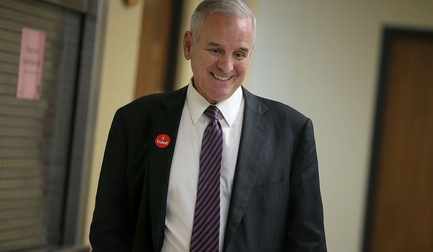 Minnesota Gov. Mark Dayton smiles after he cast his primary ballot, Tuesday, Aug. 12, 2014, in St. Paul, Minn. (AP Photo/Star Tribune, Elizabeth Flores)