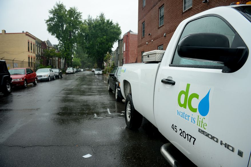 A D.C. Water and Sewer Authority truck sits parked in the flood prone Bloomingdale neighborhood to monitor streets as heavy rain moves through the region causing flooding in some areas, Washington, D.C., Tuesday, Aug. 12, 2014. (Andrew Harnik/The Washington Times) ** FILE **