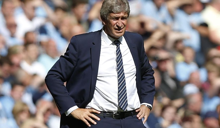 Manchester City's manager Manuel Pellegrini watches his team play against Arsenal during their English Community Shield soccer match at Wembley Stadium in London, Sunday, Aug. 10, 2014. (AP Photo/Sang Tan)