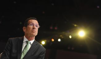 Democratic gubernatorial candidate Gov. Dannel P. Malloy waits to be introduced as the keynote speaker at the Jefferson Jackson Bailey Dinner,  Wednesday, Aug. 13, 2014, in Hartford, Conn. (AP Photo/Jessica Hill)