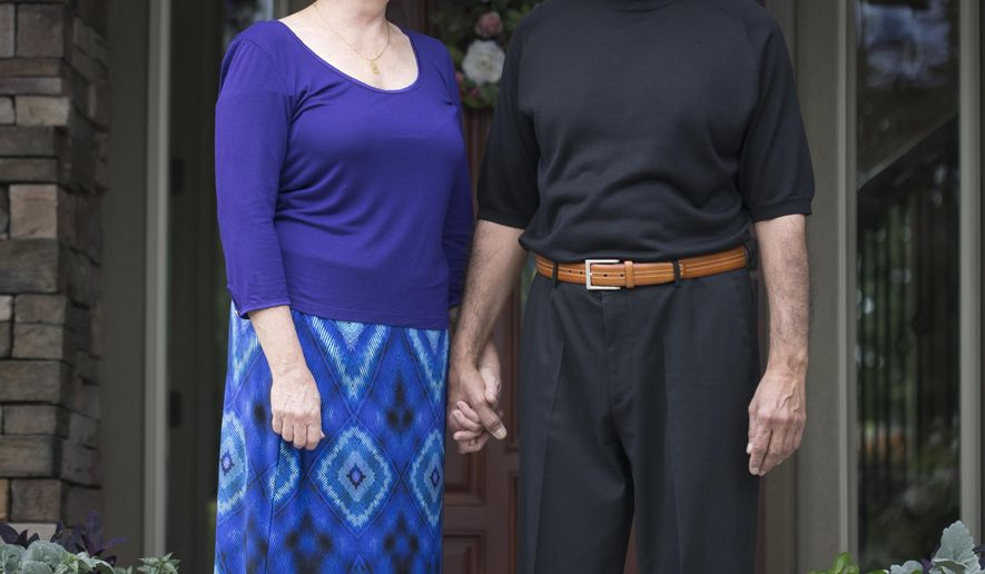 ADVANCED FOR RELEASE SATURDAY, AUGUST 16, 2014 Lori and Ather Khan have been married for 27 years. What makes their marriage unique is that she's a Christian and he's Muslim. There is more in common between the two religions than one might think, she says. (AP Photo/Idaho Statesman, Katherine Jones)