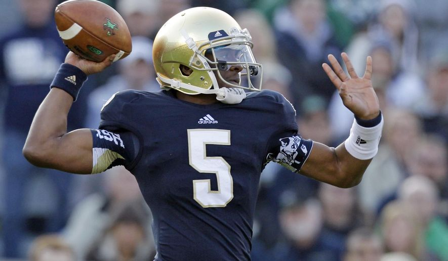FILE -- In this Nov. 17, 2012 file photo, Notre Dame quarterback Everett Golson throws against Wake Forest during the first half of an NCAA college football game in South Bend, Ind. Golson has reclaimed the job as Notre Dame's starting quarterback after being suspended last semester for academic impropriety. Coach Brian Kelly on Wednesday said Golson would start against Rice on Aug. 30 and said he hopes he will be the starter for the entire season. (AP Photo/Michael Conroy, file)