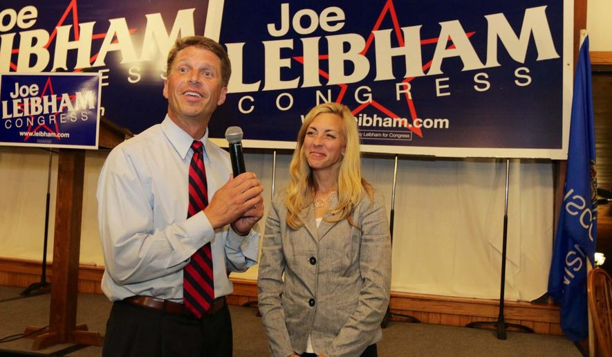Joe Leibham and his wife Heather, right, greet supporters Wednesday Aug. 13, 2014 on election night at Town and Country in Sheboygan.  Leibham told supporters he was going to wait until tomorrow as the race was too close to call at that time. (AP Photo/The Sheboygan Press, Gary C. Klein)
