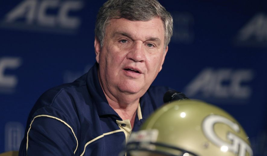 FILE - In this July 21, 2014, file photo, Georgia Tech head coach Paul Johnson answers a question during a news conference at the Atlantic Coast Conference Football kickoff in Greensboro, N.C. Johnson points to a string of high finishes in the ACC's Coastal Division as proof criticism of his program is unwarranted. Still, the Yellow Jackets enter 2014 looking to improve on back-to-back seven-win finishes, to finish in the Top 25 for the first time since 2009 and to end a streak of five straight losses to state rival Georgia. (AP Photo/Chuck Burton, File)