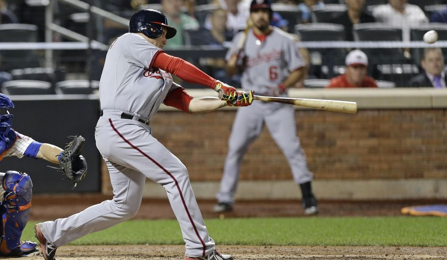Washington Nationals' Asdrubal Cabrera hits a home run during the eighth inning of a baseball game against the New York Mets Wednesday, Aug. 13, 2014, in New York.  (AP Photo/Frank Franklin II)