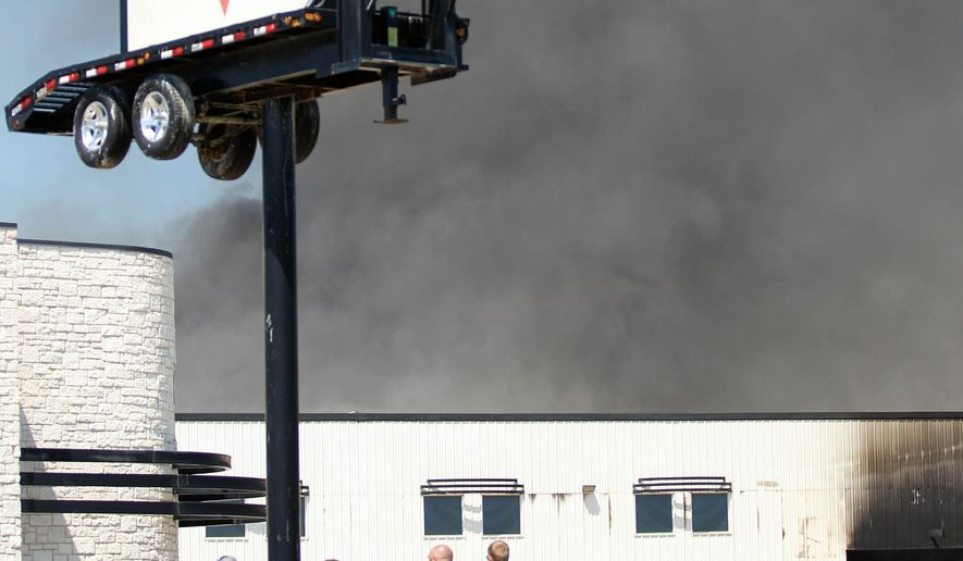 PJ Trailers, in Sumner, Texas, caught fire on Wednesday, Aug. 13, 2014 at 11:30 a.m. The fire was result of a flash explosion caused by a cutting torch. One fatality has been confirmed. (AP Photo/The Paris News, Danica Easterling)