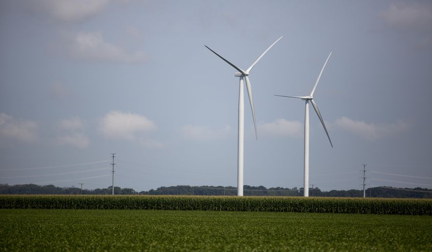 In this photo taken on Aug. 7, 2014, wind turbines sit in a field in Akron Township, Mich. Crews are making progress on construction of a wind power project in Michigan that will expand Consumers Energy's renewable energy options. (AP Photo/The Saginaw News, Coty Giannelli) ALL LOCAL TELEVISION OUT; LOCAL TELEVISION INTERNET OUT MBO  (REV-SHARE)
