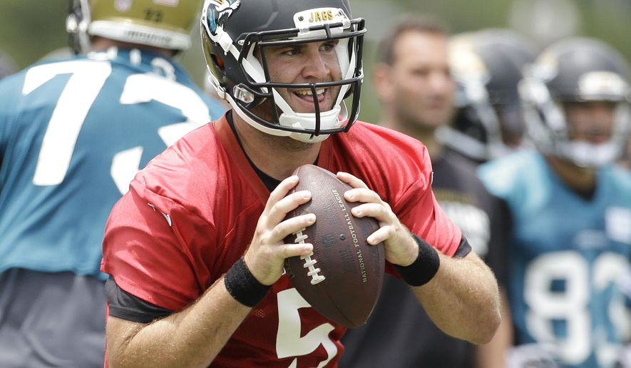 FILE - In this June 18, 2014, file photo, Jacksonville Jaguars quarterback Blake Bortles (5) looks for a receiver during a team scrimmage at NFL football minicamp in Jacksonville, Fla. The majority of teams pay their starting quarterbacks just a fraction of the base salaries of the Peyton Mannings, Tom Brady and Jay Cutler, who makes $17.5 million this season.(AP Photo/John Raoux, File)