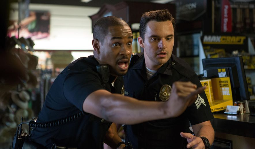 """This image released by 20th Century Fox shows Damon Wayans, Jr., left, and Jake Johnson in a scene from, """"Let's Be Cops."""" (AP Photo/20th Century Fox, Frank Masi)"""