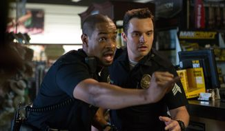 "This image released by 20th Century Fox shows Damon Wayans, Jr., left, and Jake Johnson in a scene from, ""Let's Be Cops."" (AP Photo/20th Century Fox, Frank Masi)"