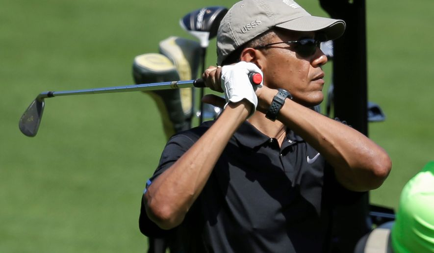 President Obama, during his two-week summer vacation on Martha's Vineyard, is staying on par to meet Tiger Woods' 269 rounds of golf. (Associated Press)