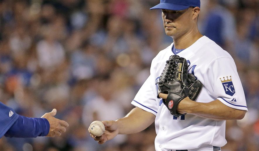 Kansas City Royals starting pitcher Jeremy Guthrie comes out of the game during the fifth inning of a baseball game against the Oakland Athletics, Tuesday, Aug. 12, 2014, in Kansas City, Mo. (AP Photo/Charlie Riedel)