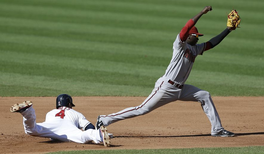 Arizona Diamondbacks' Didi Gregorius, right, gets Cleveland Indians' Mike Aviles out at second base in the fourth inning of the first baseball game of a doubleheader, Wednesday, Aug. 13, 2014, in Cleveland. (AP Photo/Tony Dejak)