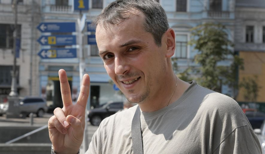 In this Monday, Aug. 11, 2014 photo Denis Lavrienko, 36, gestures during a conversation in Ukraine's capital, Kiev. Since a separatist insurgency broke out in eastern Ukraine in March, entire swaths of Ukrainian society _ either through a government summons or their own patriotism _ have suddenly been thrust into battle, many of them with little or no combat experience. With the government desperate for more fighters and medics, a draft has brought in a wave of needed additions to what had been a neglected army. And amid a surge of patriotic indignation tipping over into martial fervor, volunteer battalions have proven an indispensable boost as well. (AP Photo/Efrem Lukatsky)
