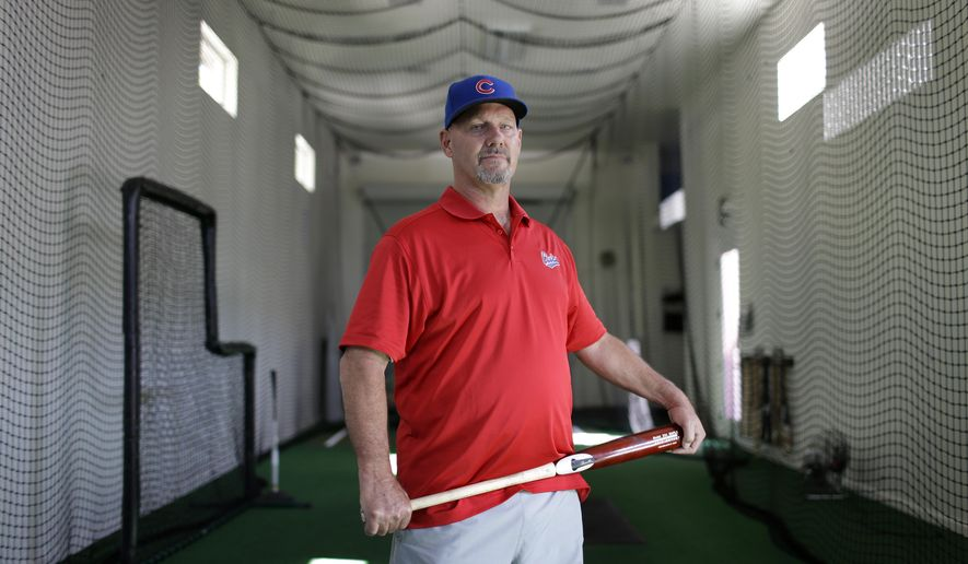 In this Aug. 12, 2014 photo, Mike Bryant poses in an indoor batting cage at his home in Las Vegas. Mike Bryant taught his son Kris Bryant, a top prospect of the Chicago Cubs, and Joey Gallo, a top prospect for the Texas Rangers, how to hit while they were growing up in Las Vegas. (AP Photo/John Locher)