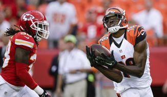 Cincinnati Bengals wide receiver A.J. Green (18) makes a catch against Kansas City Chiefs cornerback Ron Parker (38) in the first half of an NFL preseason football game Thursday, Aug. 7, 2014, in Kansas City, Mo. (AP Photo/Nati Harnik)