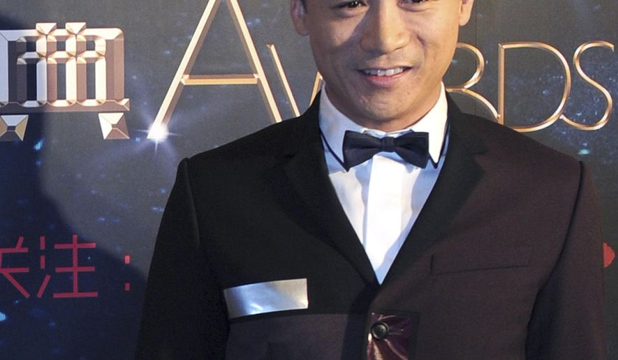 "In this photo taken Tuesday, March 18, 2014, actor Gao Hu poses on the red carpet during the award ceremony of the Celebrity Citizens in Beijing, China. Gao, 40, who had a small part as a soldier in Zhang Yimou's 2011 movie ""The Flowers of War,"" has become the latest Chinese celebrity to face drug charges in a wave of detentions that an official said Wednesday, Aug. 13, 2014 is one of China's sternest crackdowns on illegal drug use in two decades. (AP Photo) CHINA OUT"