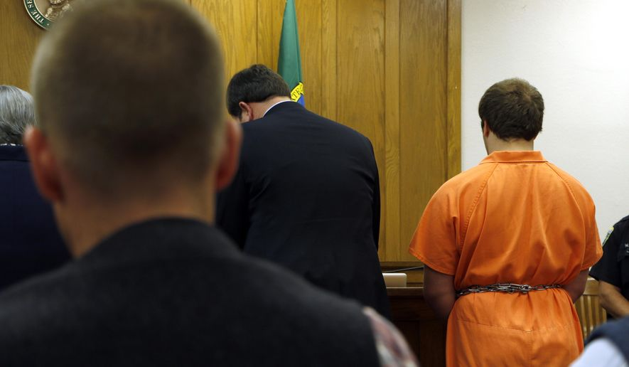 Gabriel Gaeta, right, stands next to his lawyer at a hearing in Kitsap County Superior Court, on Monday, Aug. 11, 2014, in Port Orchard, Wash. A judge found probable cause to detain the 17-year-old boy as an adult for the death and sexual assault of a 6-year-old girl. (AP Photo/Rachel La Corte)